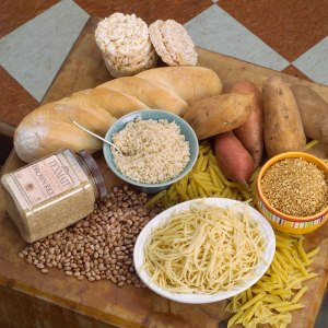 Grains: pasta, bread (includes pita pretzels etc), noodles, flour, wheat, cereal, rice, oats, corn. Many processed foods include grain derived ingredients. Not grains: potato, sweet potato, quinoa